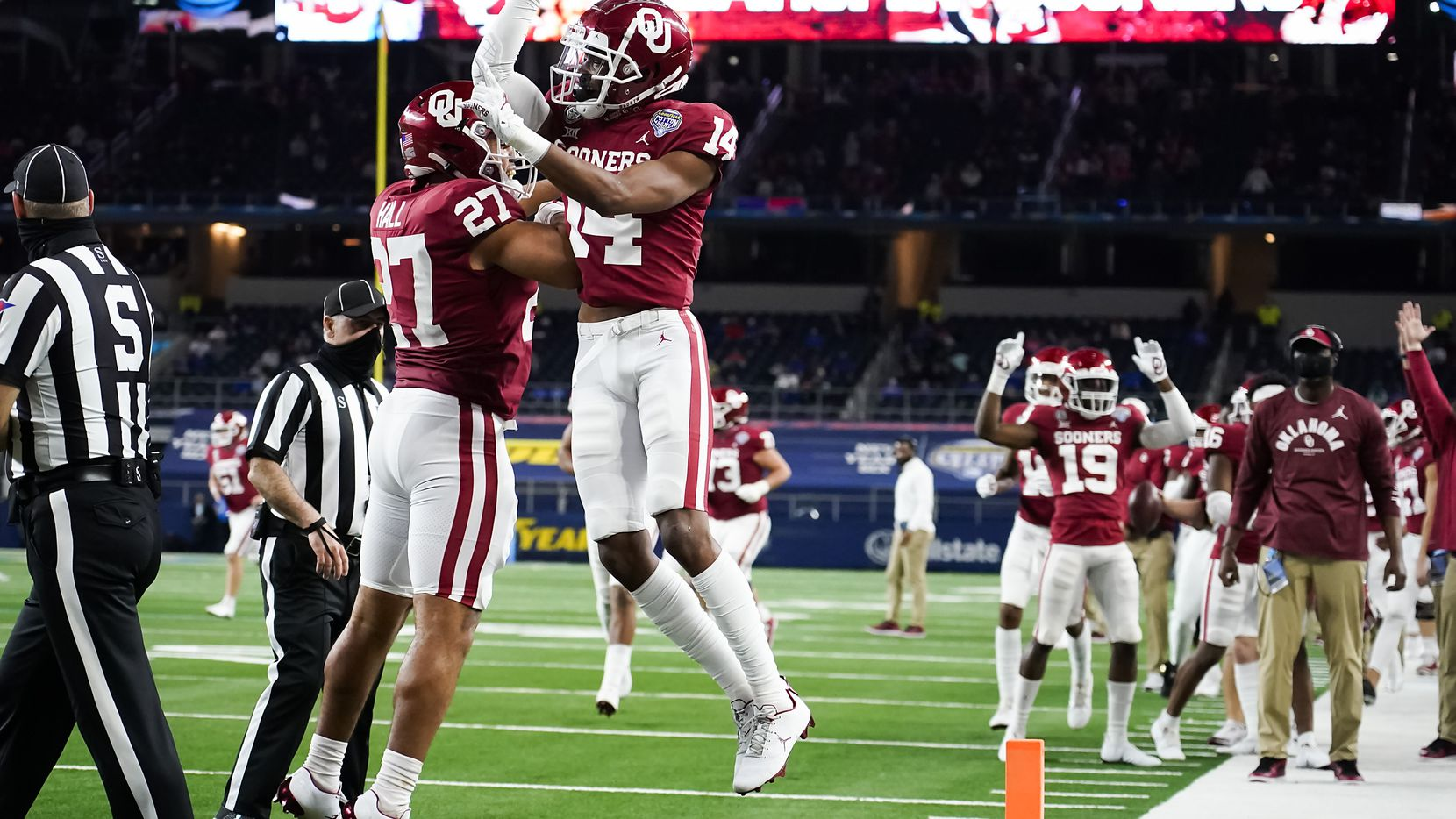 Oklahoma tight end Jeremiah Hall (27) celebrates with wide receiver Charleston Rambo (14) after Rambo scored on a 20-yard td catch during the second half of the Cotton Bowl Classic against Florida at AT&T Stadium on Wednesday, Dec. 30, 2020, in Arlington.