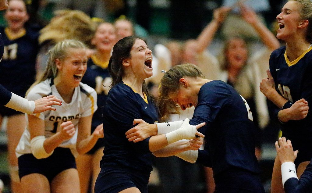 Highland Park High School setter Jeanne Tulimieri (4) and Highland Park High School outside hitter Kate Nugent (2) celebrate with team mates as Highland Park wins the match after game four as Lebanon Trail High School played Highland Park High School in a Class 5A Region II quarterfinal match played at Richardson Berkner High School on Monday night, November 12, 2019. (Stewart F. House/Special Contributor)