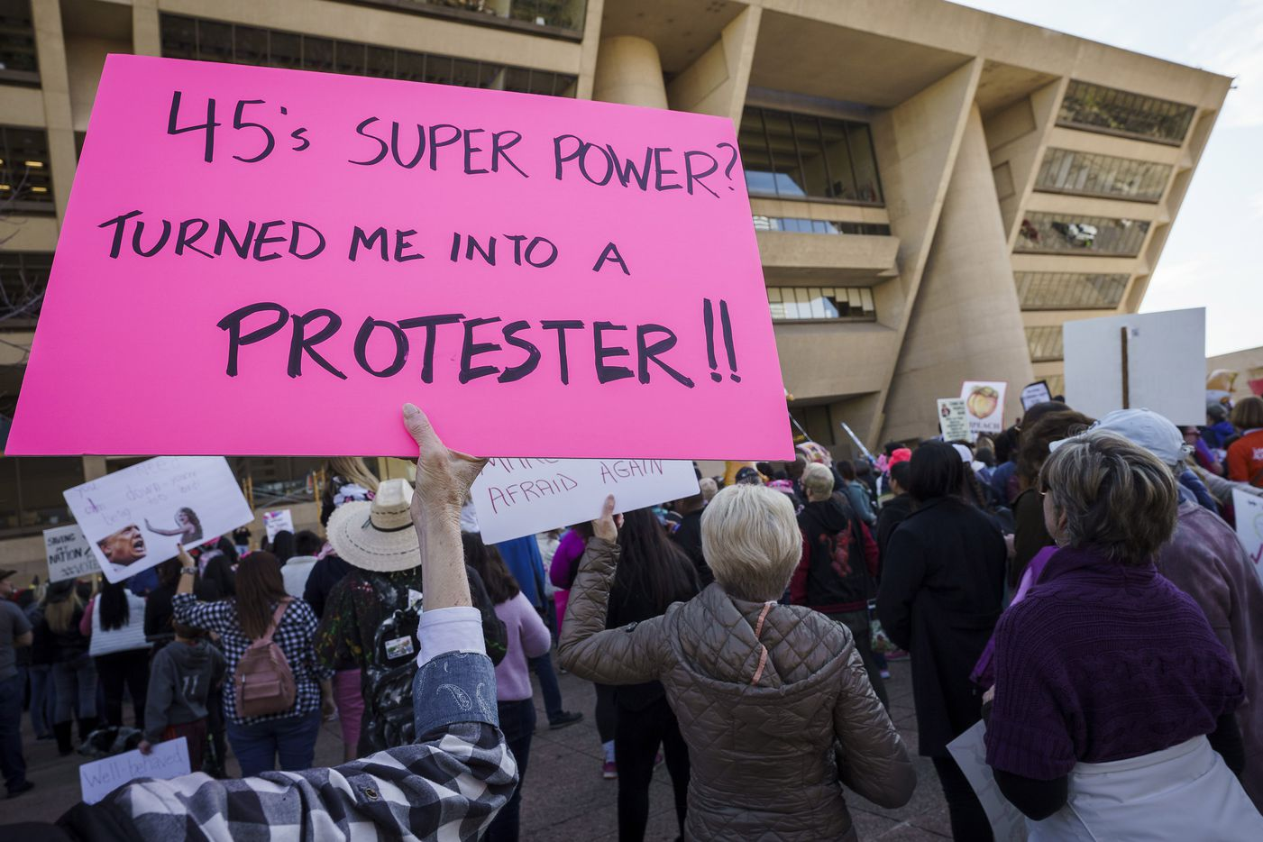 Participants in the 2020 Dallas Women's March rally at Dallas City Hall on Sunday, Jan. 19, 2020, in Dallas.