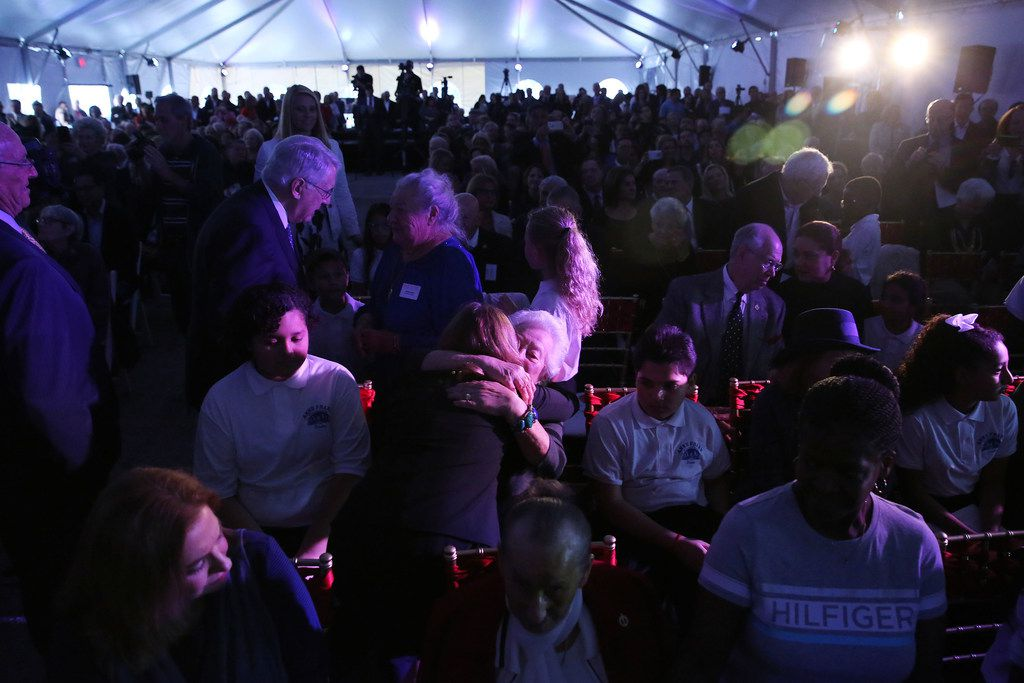 Mary Pat Higgins, president and CEO of the Dallas Holocaust Museum, hugs Magie Furst, a Holocaust survivor, at the groundbreaking ceremony for the new Dallas Holocaust and Human Rights Museum in the West End of Dallas Tuesday October 10, 2017. Furst was part of the Kindertransport rescue efforts that brought Jewish children to Great Britain from Nazi Germany during the Holocaust. The ceremony also honored local Dallas-Fort Worth Holocaust survivors. At 300 North Houston Street the new museum will be 51,000 square feet and set to open in the summer of 2019.