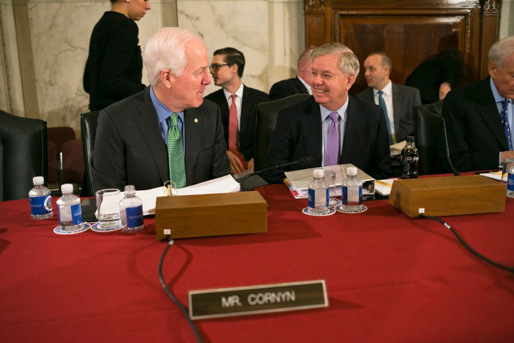 Sens. John Cornyn (R-Texas) and Lindsey Graham (R-S.C.) talk before the start of the confirmation hearing.