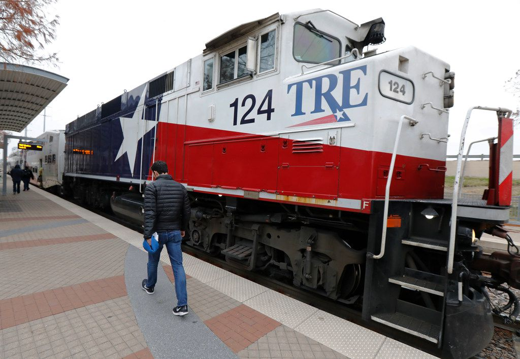 A Dallas Morning News reporter walks to board the Trinity Railway Express at Union station in Dallas to commute to CentrePort/DFW Airport station in Fort Worth. The TRE will miss a federal deadline to implement safety technology, which puts it in danger of a Jan. 1 shutdown.  (2017 File Photo/Staff)