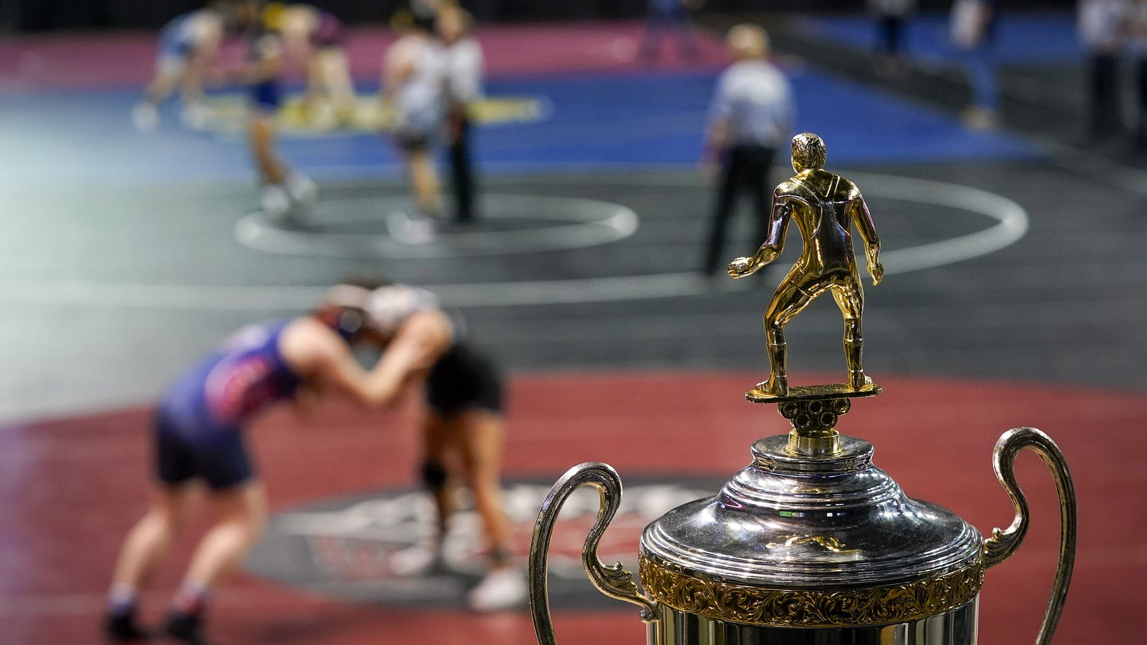 The championship trophy is seen as wrestlers compete during the NCWA  national championships at the Allen Event Center on Friday, March 13, 2020, in Allen, Texas. The event center was used as a filming location for a new wrestling film released this week.