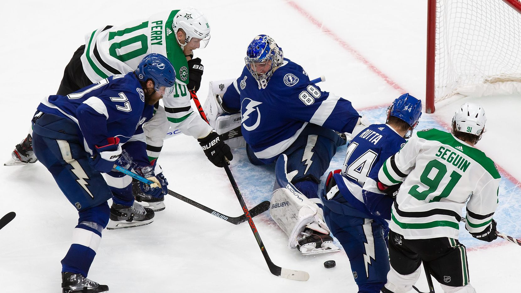 Corey Perry (10) of the Dallas Stars pokes the game winner past goaltender Andrei Vasilevskiy (88) of the Tampa Bay Lightning during Game Five of the Stanley Cup Final at Rogers Place in Edmonton, Alberta, Canada on Saturday, September 26, 2020.