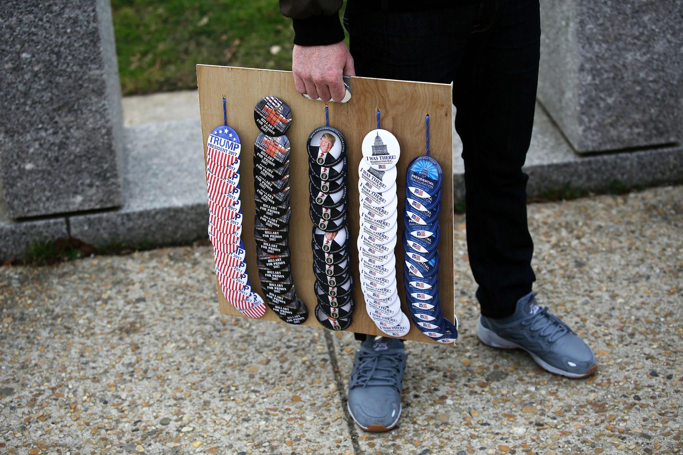 A vendor sells Donald Trump buttons along Constitution Avenue on January 19, 2017 in Washington, DC. President-elect Donald Trump will be sworn in January 20 as the 45th President of the United States.