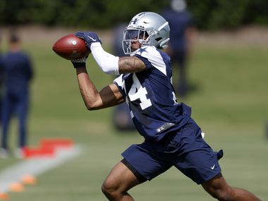 Dallas Cowboys rookie cornerback Kelvin Joseph (24) caches a pass during a defensive drill at rookie minicamp at the The Star in Frisco, Texas, Saturday, May 15, 2021.