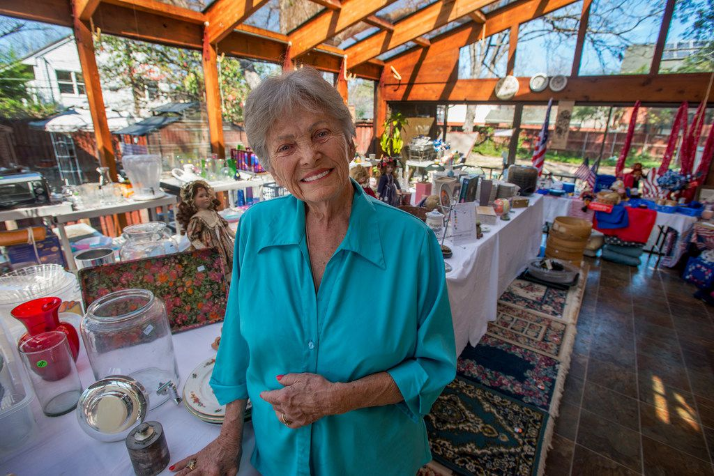 Harryette Ehrhardt on the sun porch of her home on Swiss Avenue where she's in the middle of an estate sale to dispose of 50-plus years of belongings.