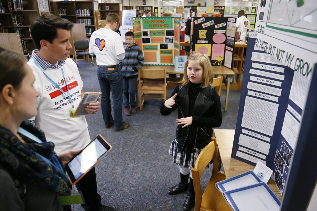 Josey Edgar, a fourth-grader from Dealey Montessori, presented her project to judges from Texas Instruments during the Dallas ISD District Science Fair in 2015. Dealey Montessori was one of several local campuses named a 2016 Blue Ribbon School by the U.S. Department of Education on Wednesday.   (Kye R. Lee/The Dallas Morning News)