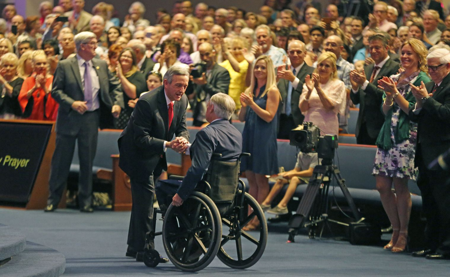 First Baptist Dallas pastor Dr. Robert Jeffress greets Texas Governor Greg Abbott during the 150th anniversary service at First Baptist Church of Dallas Sunday, July 29, 2018.
