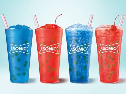 Starting in summer 2021, little orbs of sugar called Bursting Bubbles can be added to any drink at Sonic. Pictured are two new drinks: the Cherry Burst and the Blue Burst.