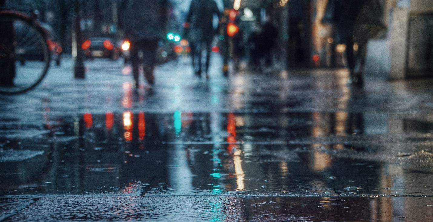 Wet pavement during night