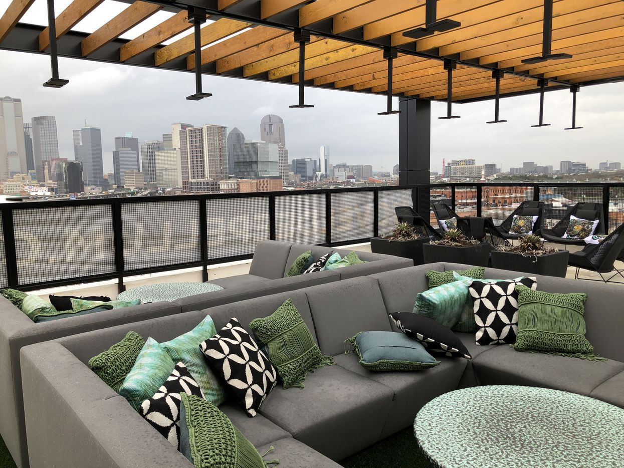 The rooftop lounge of the Novel Deep Ellum apartments offers views of downtown.