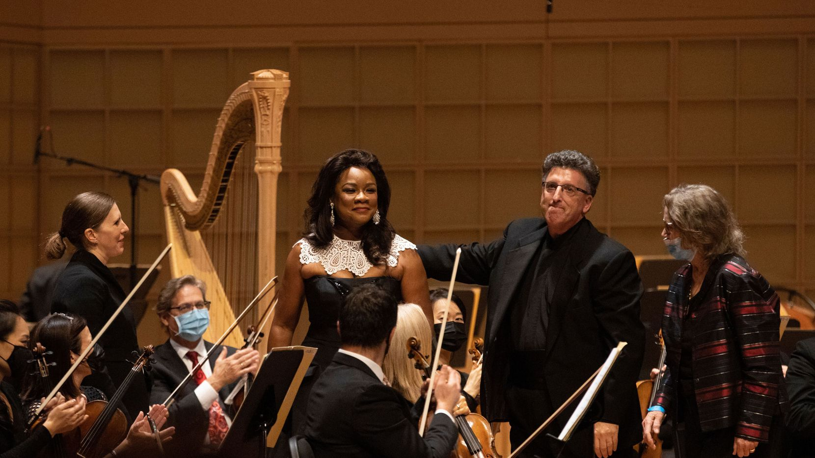 """Conductor Lidiya Yankovskaya, mezzo-soprano Denyce Graves, pianist Jeffrey Biegel and composer Ellen Taaffe Zwilich, after a Dallas Symphony Orchestra world premiere of Zwilich's """"Remembering Ruth Bader Ginsburg,"""" at the Meyerson Symphony Center in Dallas, on Oct. 7, 2021."""