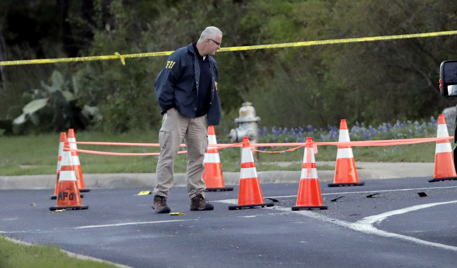 Officials work near the site of Sunday's deadly explosion.