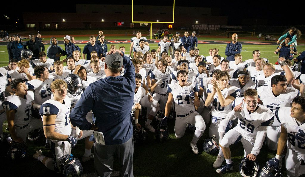 After looking at the final score, the Flower Mound Jaguars celebrate their victory against the Coppell Cowboys in a high school football game in Coppell, Texas on Friday, November 2, 2018. The Jaguars beat the Cowboys 31 to 17. (Daniel Carde/The Dallas Morning News)