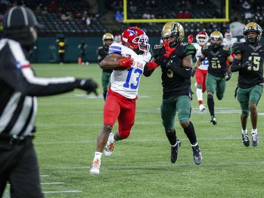 Duncanville senior running back Roderick Daniels Jr. (13) battles DeSoto junior safety Devyn Bobby (3) for yardage during the first half of a Class 6A Division I Region II final high school football game, Saturday, January 2, 2021.  Duncanville won 56-28. (Brandon Wade/Special Contributor)