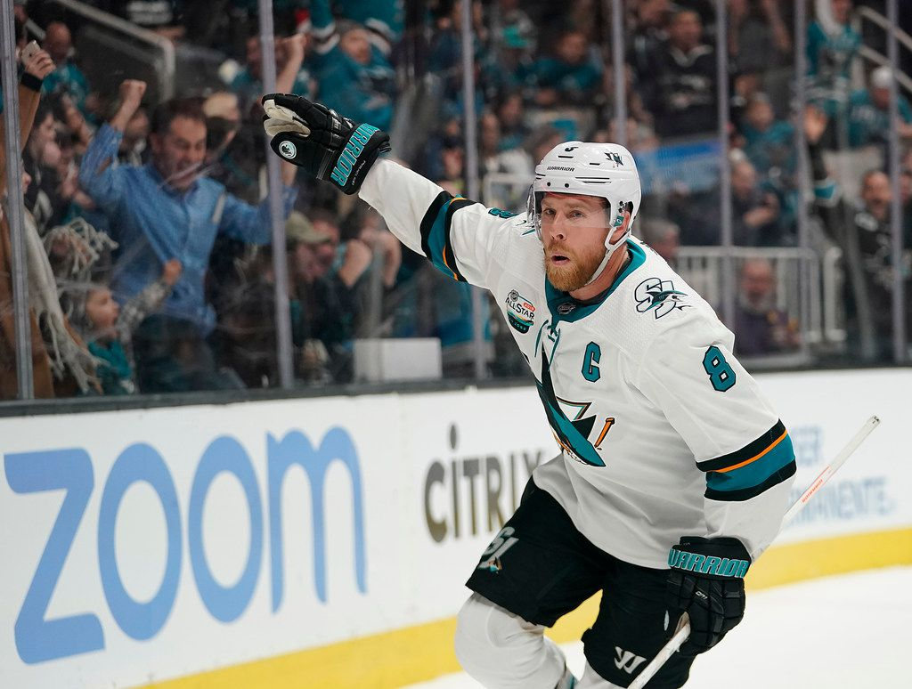 FILE - In this Dec. 22, 2018, file photo, San Jose Sharks center Joe Pavelski (8) celebrates after scoring a goal against the Los Angeles Kings during the third period of an NHL hockey game in San Jose, Calif.  San Jose is up against the cap after re-signing defenseman Erik Karlsson to a long-term contract and have also lost captain Joe Pavelski to Dallas. The Stars signed Pavelski to a $21 million, three-year contract, adding another scoring threat to their leading duo of Tyler Seguin and captain Jamie Benn. (AP Photo/Tony Avelar, Fle)