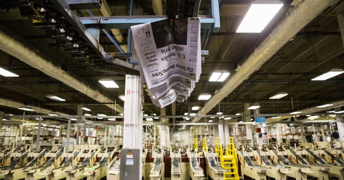 Copies of the April 7, 2017 issue of The Dallas Morning News newspapers move overhead on April 6, 2017 at The Dallas Morning News' North Plant in Plano, Texas.