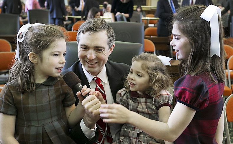 State Sen. Van Taylor, R-Plano, seen here with his daughters before the start of official business on Jan. 13, has filed a bill to allow school districts to determine their own start dates.