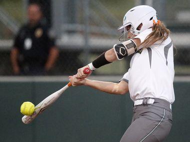 Prosper catcher Elizabeth Moffit (6) gets a big hit in the third inning as Denton Guyer High School played Prosper High School in the second of a best-of-three Class 6A Region I softball quarterfinal at Prosper High School in Prosper on Thursday, May 13, 2021.