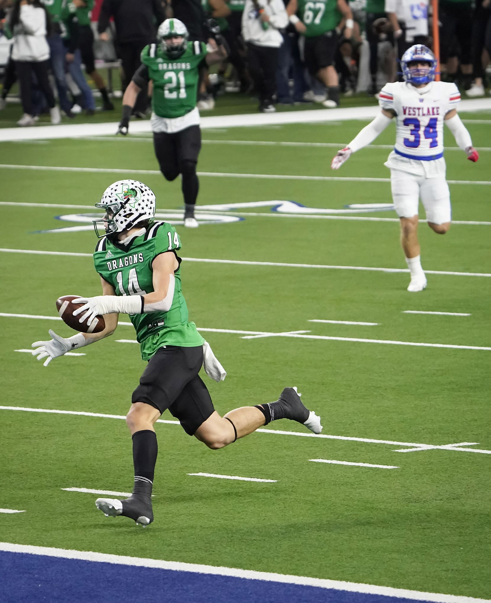 Southlake Carroll wide receiver Brady Boyd (14) scores on a 49-yard touchdown play during the first quarter of the Class 6A Division I state football championship game against Austin Westlake at AT&T Stadium on Saturday, Jan. 16, 2021, in Arlington, Texas.