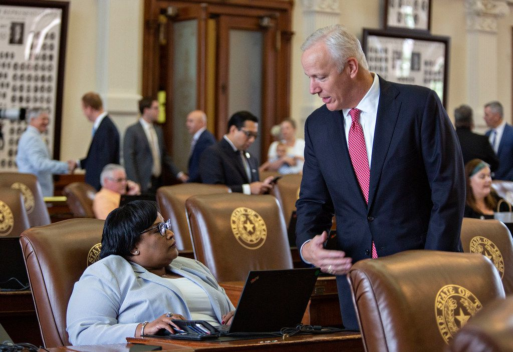 State Rep. Toni Rose chats with Rep. James Frank on the House floor just before Sine Die at the State Capitol of Texas on May 27, 2019 in Austin, Texas.