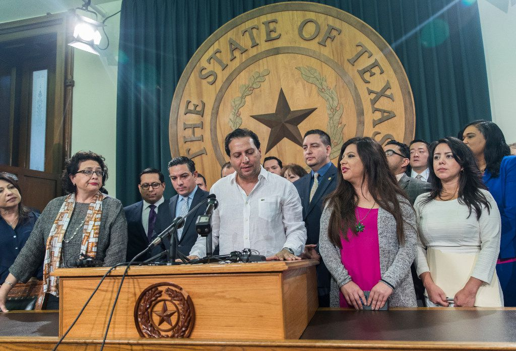 Texas House Rep. Poncho Nevarez of Eagle Pass, shown here with fellow Democrats in 2017, said Thursday he is stepping down due to addiction. News broke late Wednesday that he was being investigated for dropping an envelope of cocaine at an Austin airport.