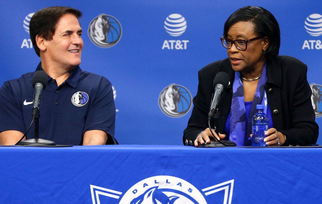 Dallas Mavericks owner Mark Cuban, left, looks on as Cynthia Marshall, new interim CEO of the team, addresses the media Monday, Feb. 26, 2018, in Dallas. (AP Photo/Ron Jenkins)