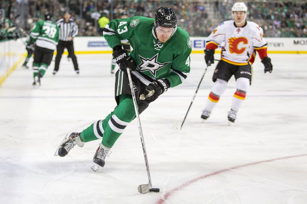Dallas Stars right wing Valeri Nichushkin (43) brings the puck up the ice during the first period of an NHL hockey game against the Calgary Flames at the American Airlines Center on Monday, Jan. 25, 2016, in Dallas. (Smiley N. Pool/The Dallas Morning News)