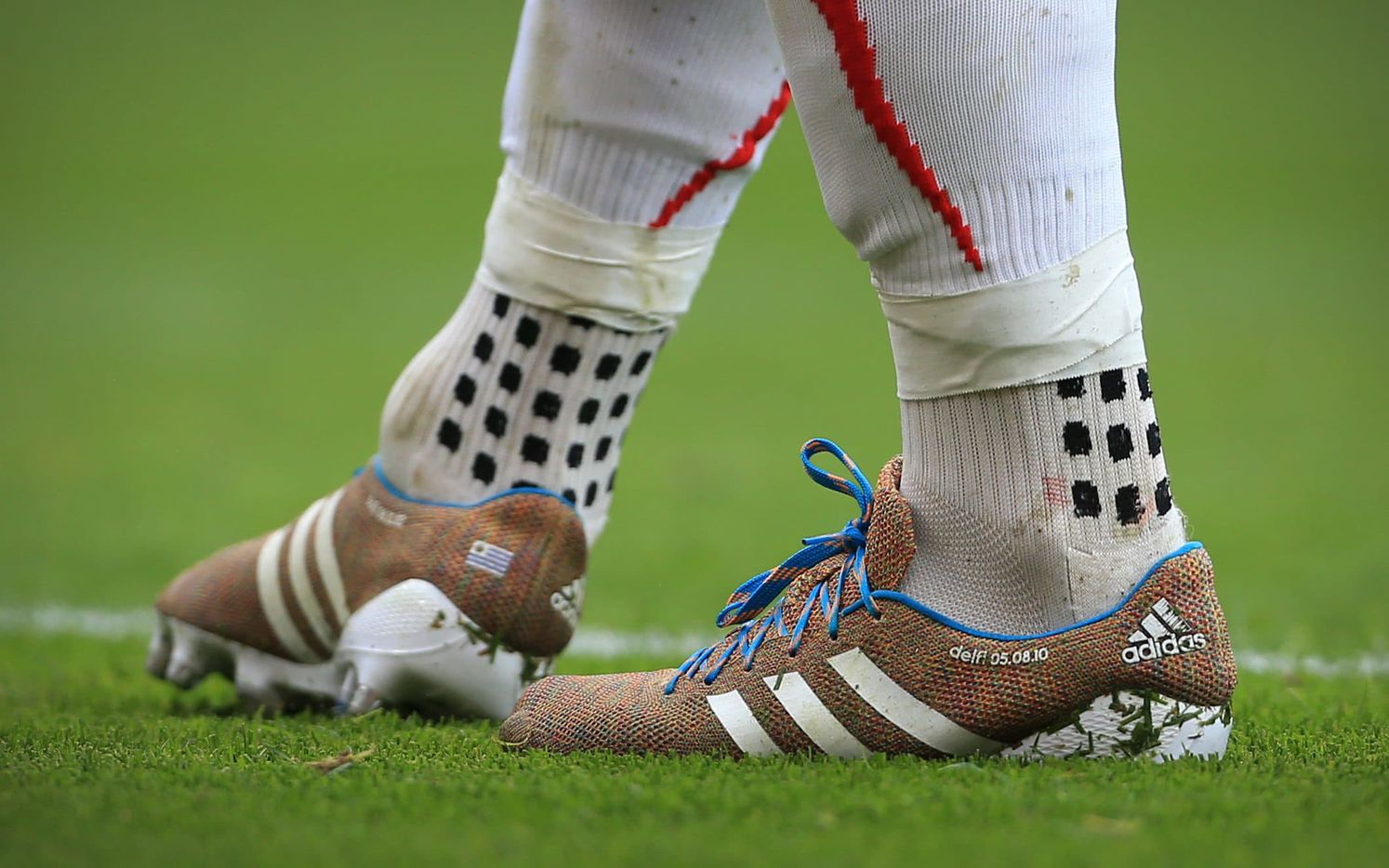 Luis Suarez wearing TRUsox while playing for Liverpool. The distinctive wet grip pattern is shown.