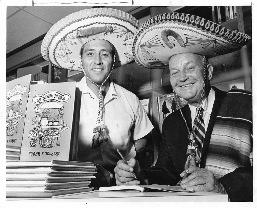 """Gilbert Martinez , left, son of the founder of El Fenix restaurants, and Dallas Morning News columnist Frank X. Tolbert, dressed in Mexican sombreros at an autograph party for Tolbert's book """"A Bowl of Red"""" a history of his favorite food, chili con carne, in August 1966."""