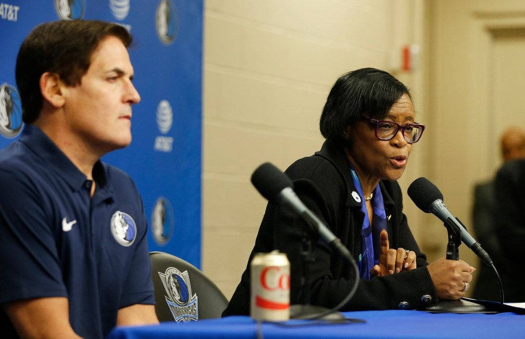 FILE - Dallas Mavericks CEO Cynthia Marshall answers questions from the media as Mavericks owner Mark Cuban listens during a press conference at American Airlines Center in Dallas on Monday, Feb. 26, 2018. (Vernon Bryant/The Dallas Morning News)