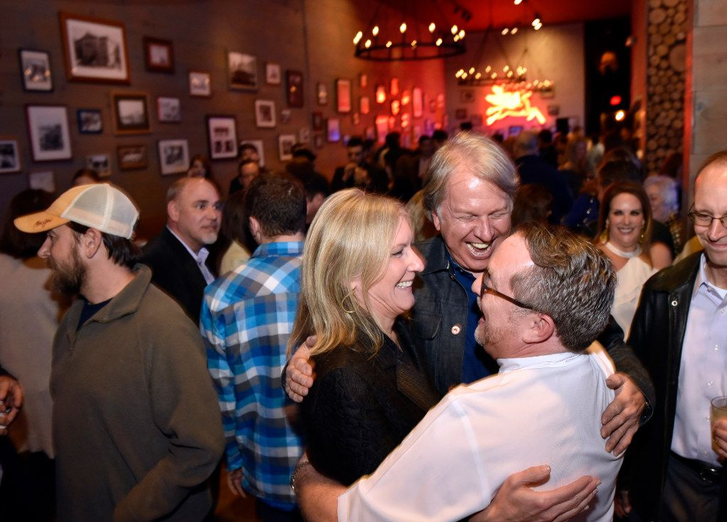 Wanda Gierhart, left, Chef Dean Fearing, hug Jeffrey Kollinger, right, owner of Tillman's Roadhouse restaurant, as they see each other during a relaunch party for the restaurant in Bishop Arts, on Tuesday, Jan. 10, 2017 in Dallas. Ben Torres/Special Contributor