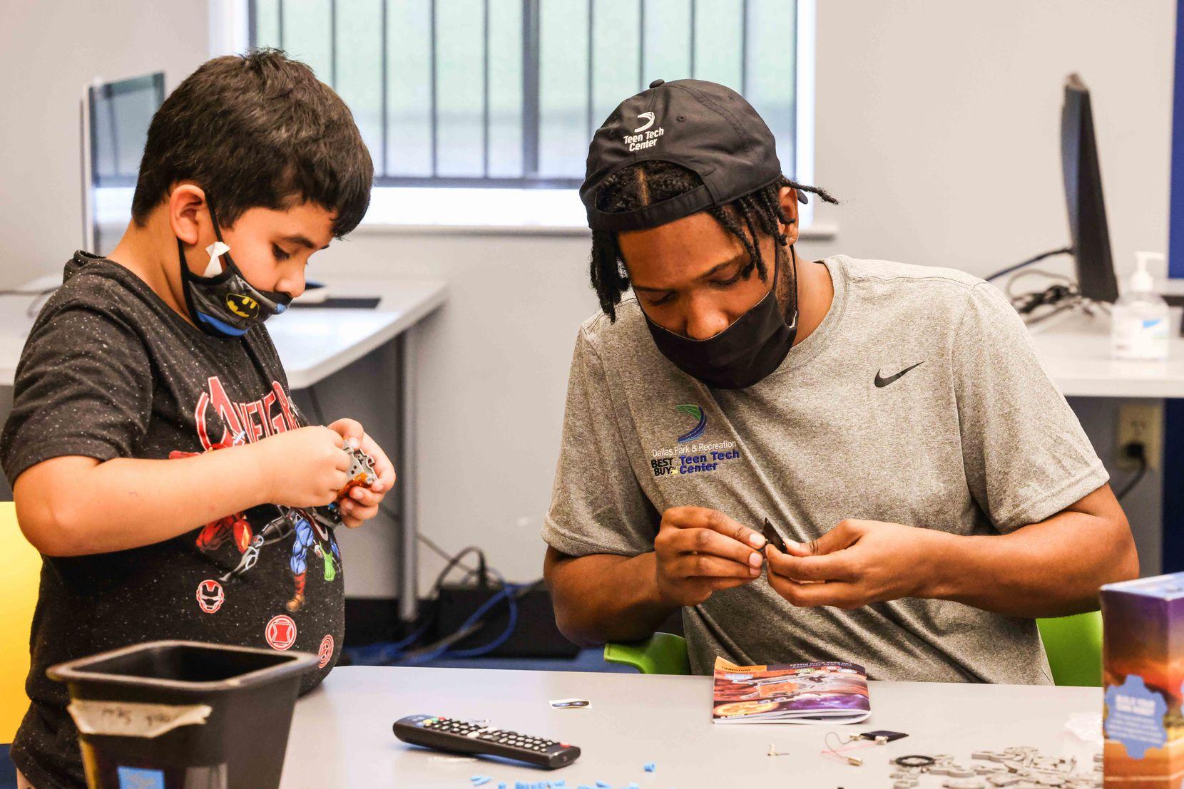 Lorenzo Reid-Deloatche works Jadin Torres, as part of the Children's Technology Program at the Juanita J. Craft Recreation Center Annex in Dallas on Thursday, June 10, 2021.