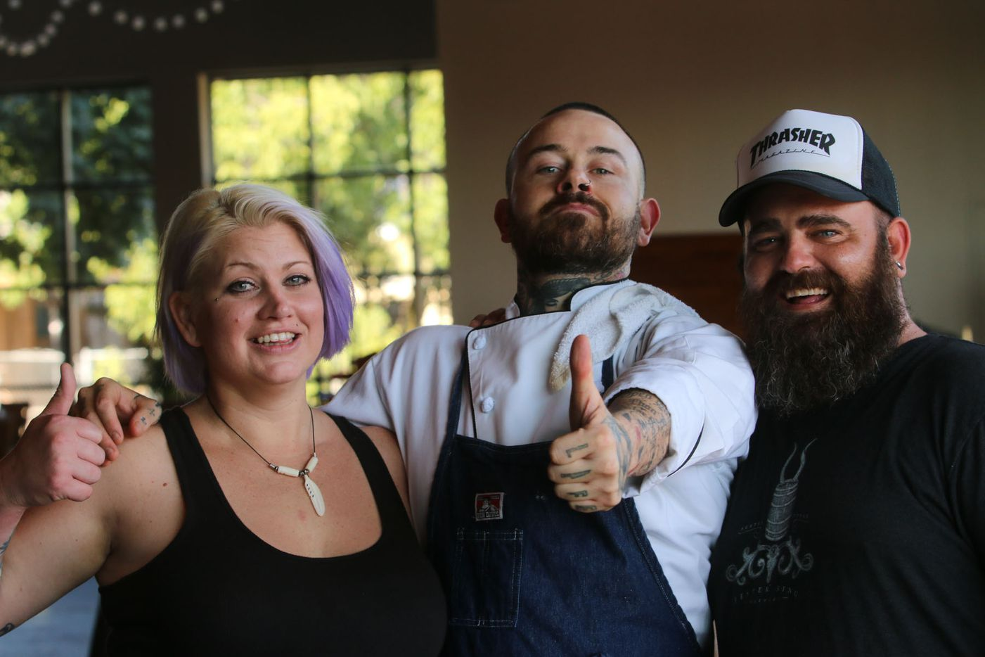 Chef Justin Box (center) with Michelle Carrow and David Reynolds at Box's summer pop up dinner Summer Shenanigans at 3015 in Trinity Groves on July 26,2015.