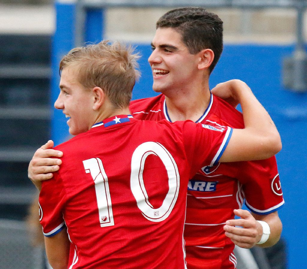 FC Dallas team mates Paxton Pomykal (10) and Adrian Ramos (9) embrace after Pomykal scored the first goal of the game during the first half as FC Dallas U18 Academy hosted CF Monterrey Rayados in the Dallas Cup Super Group final at Toyota Stadium in Frisco on Sunday, April 16, 2017. (Photo by Stewart F. House)