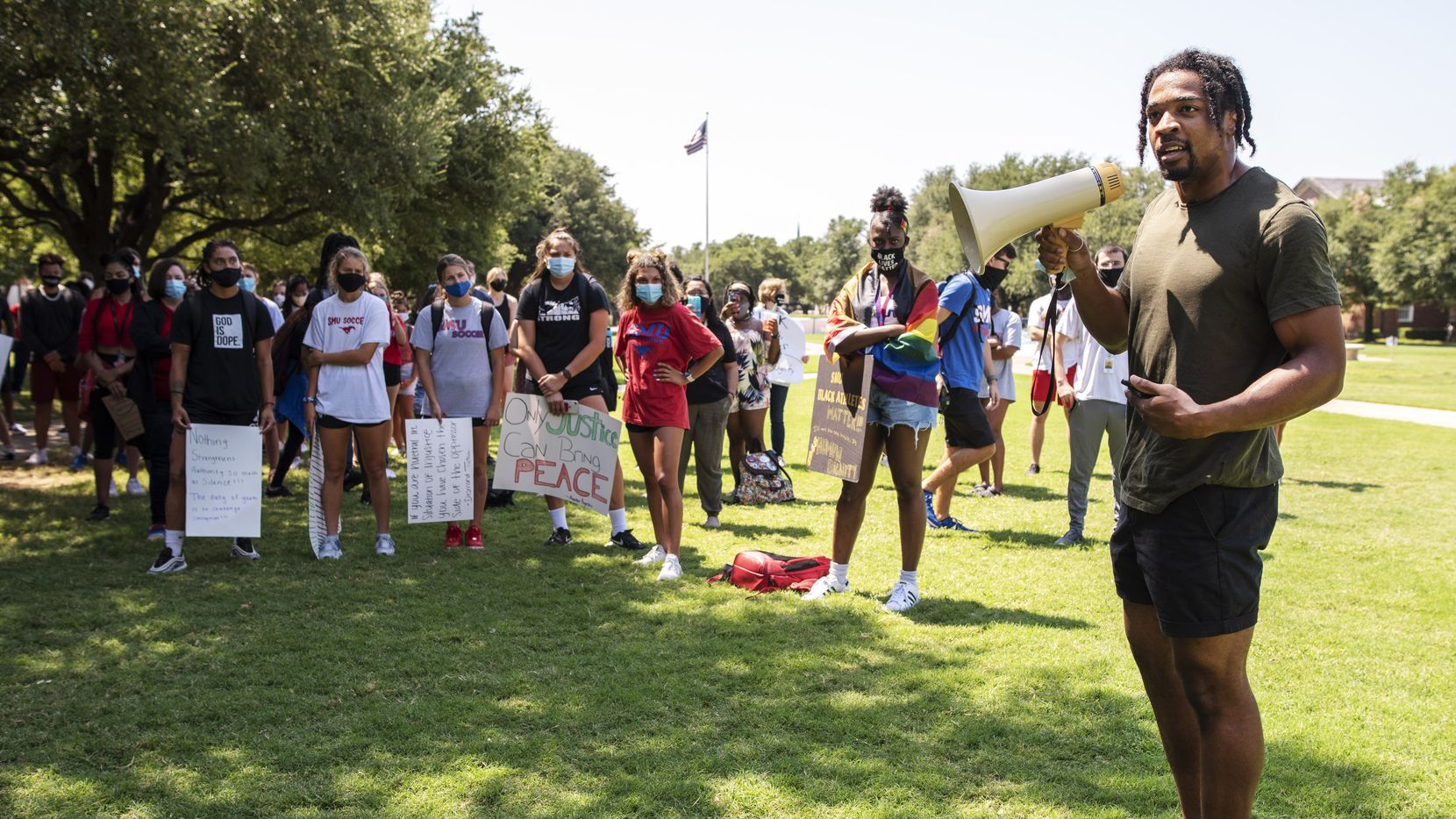 SMU safety Ra-Sun Kazadi speaks during a Black Lives Matter movement march conducted by SMU Black student athletes on the campus in Dallas, Aug. 28, 2020.