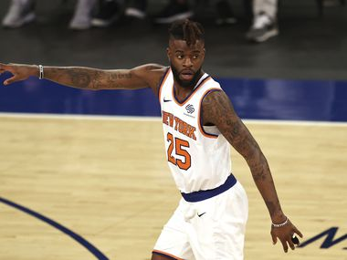 Reggie Bullock (25) of the New York Knicks celebrates his three point shot in the first quarter against the Charlotte Hornets at Madison Square Garden on May 15, 2021, in New York.
