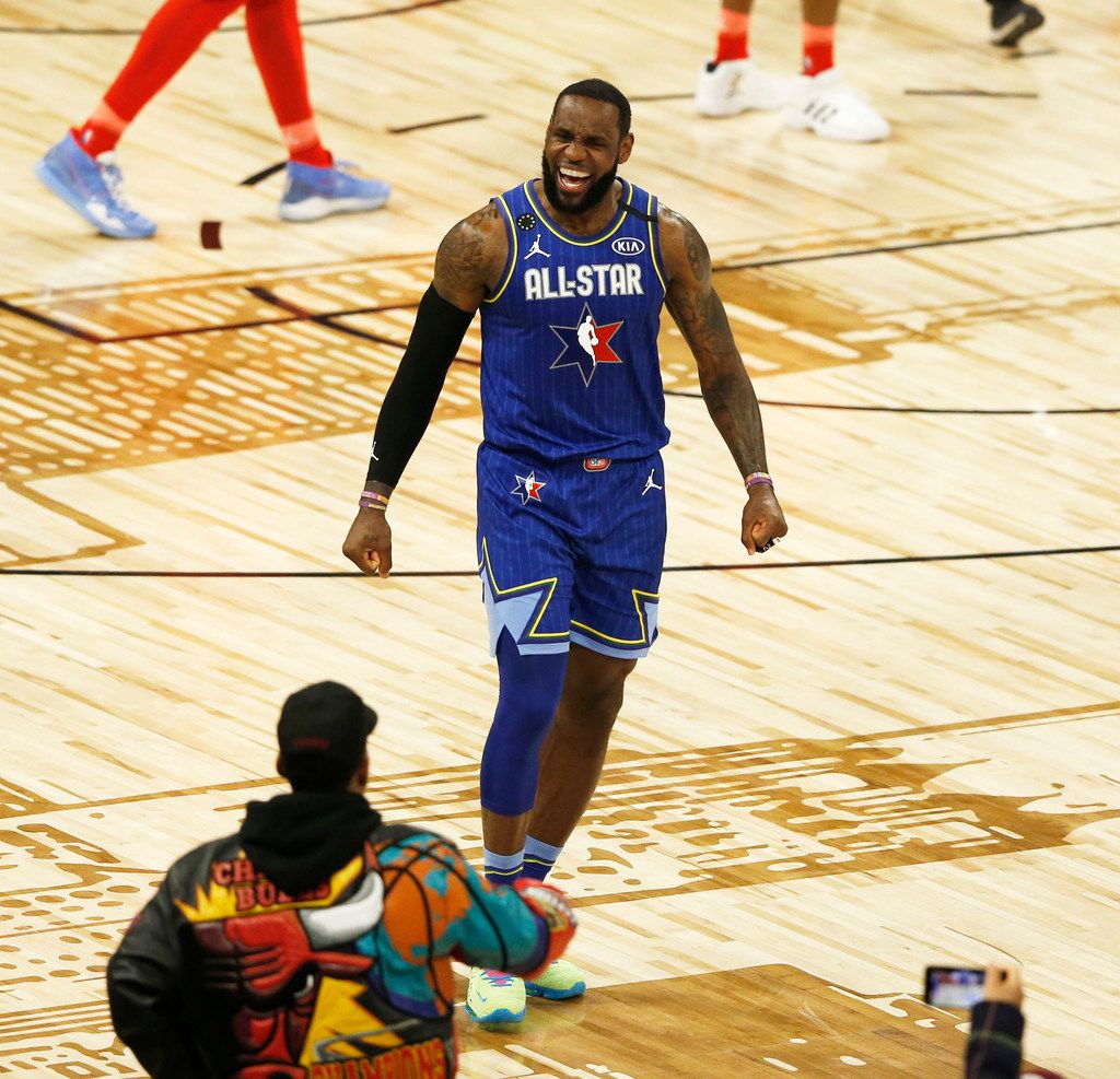 Team LeBron's LeBron James (2) celebrates after teammate Anthony Davis (2) made a free throw to defeat Team Giannis 157-155 in the NBA All-Star 2020 game at United Center in Chicago on Sunday, February 16, 2020. (Vernon Bryant/The Dallas Morning News)