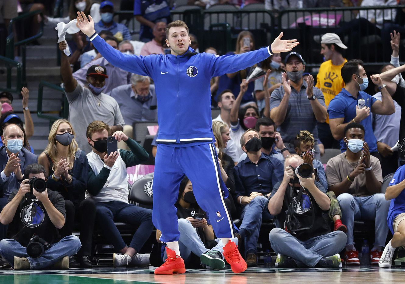Dallas Mavericks guard Luka Doncic jumps out of his seat and onto the floor, celebrating Boban Marjanovic's second half play against the Utah Jazz at the American Airlines Center in Dallas, Wednesday, October 6, 2021. The Mavericks defeated the Jazz, 111-101. (Tom Fox/The Dallas Morning News)
