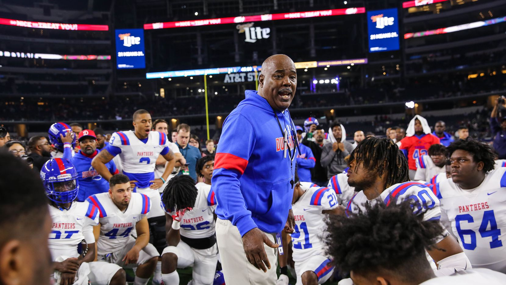 Duncanville's coach Reginald Samples consoles speaks to his team after losing a Class 6A Division I state championship game against North Shore at the AT&T Stadium in Arlington, on Saturday, December 21, 2019. North Shore won 31-17.