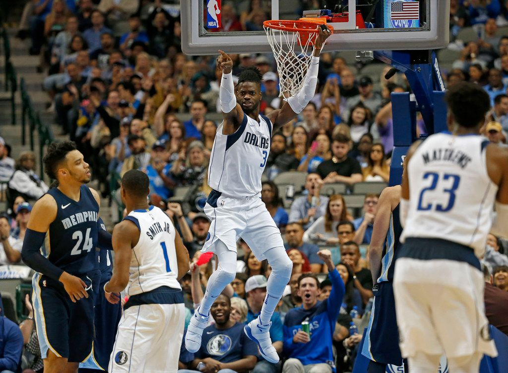 Dallas Mavericks forward Nerlens Noel (3) hangs on the rim after dunking the ball against Memphis Grizzlies during the second half at American Airlines Center on Wednesday, Oct. 25, 2017, in Dallas. (Jae S. Lee/The Dallas Morning News)