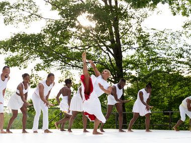 """The Dallas Black Dance Theatre performing Darrell Grand Moultrie's """"Like Water"""" at Jacob's Pillow. In the front is dancer McKinley Willis."""