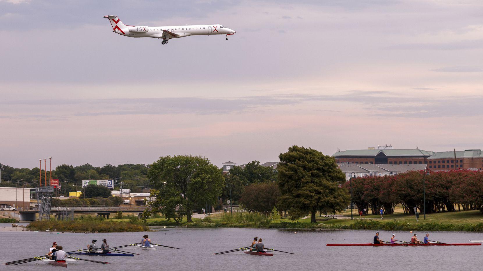 A JSX jet flies over Bachman Lake as it prepares to land at Dallas Love Field.