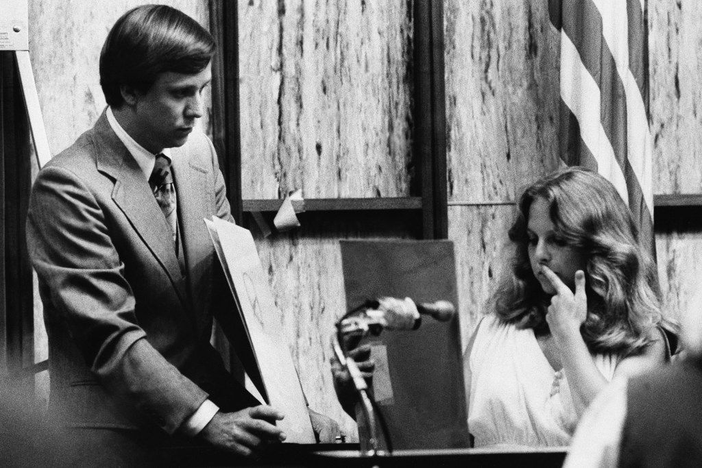 Nita Jane Neary looks at drawing in court while prosecution attorney Larry Simpson holds more during the murder trial of Ted Bundy in Miami on July 18, 1979. After undergoing hypnosis, Neary pointed out Bundy when asked if she could identify the man she was fleeing in a sorority house the night two women were murdered.