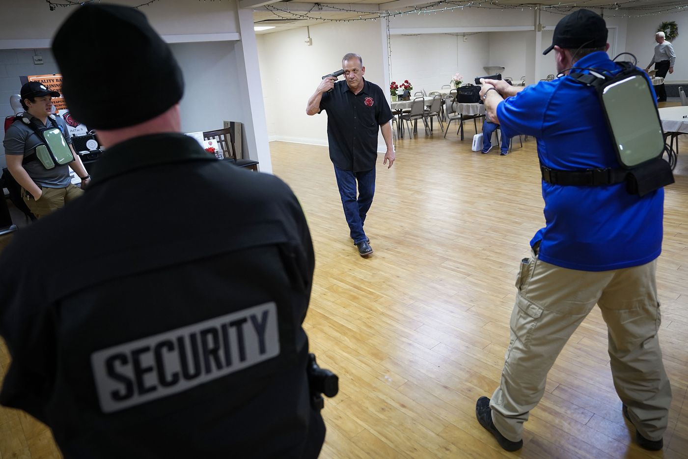 Jack Mills of Virtual Tactical Training Resources (center) portrays a shooter in an active-shooter demostration with David Riggall of Sheepdog Defense Group (right) during a church safety seminar at North Pointe Baptist Church on Sunday, Jan. 26, 2020, in Hurst, Texas.