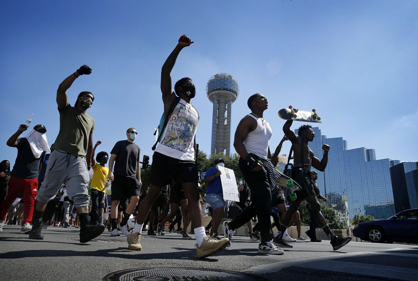 Protestors supporting Black Lives Matters rally march past Reunion Tower on their way to Dealey Plaza after a rally at Dallas City Hall, Wednesday, June 3, 2020. (Tom Fox/The Dallas Morning News)