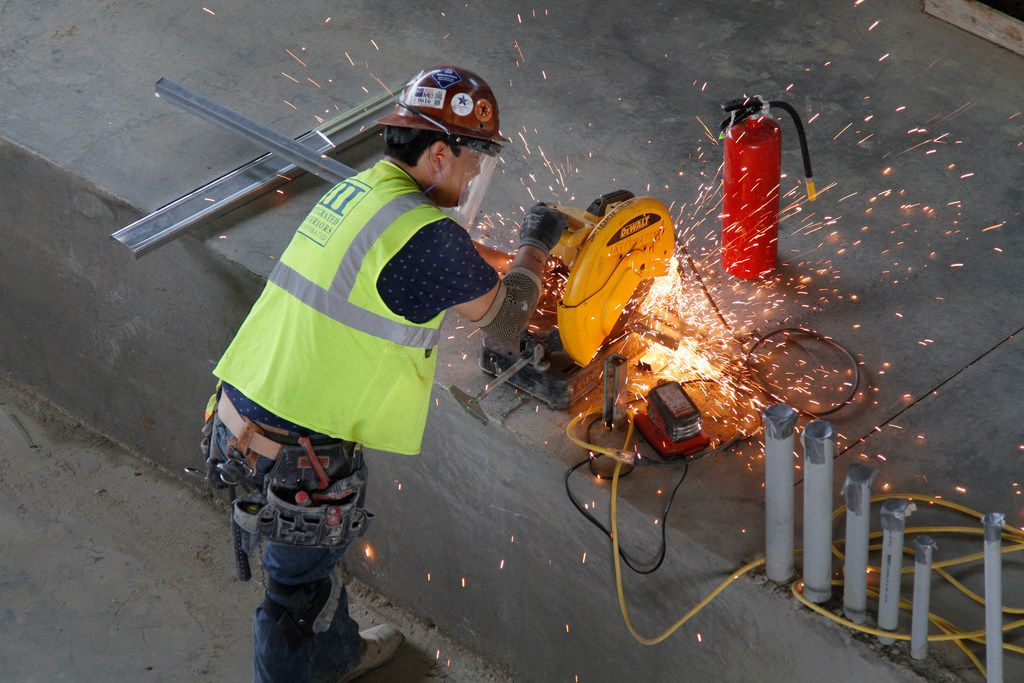 Sparks fly as a worker cuts a metal pipe in the arena area of Texas Live! in Arlington. The Arena is the main activity center of the new entertainment complex that includes retail, restaurants, a live music venue, a hotel and a new ballpark for the Texas Rangers. The first phase opened in early August.