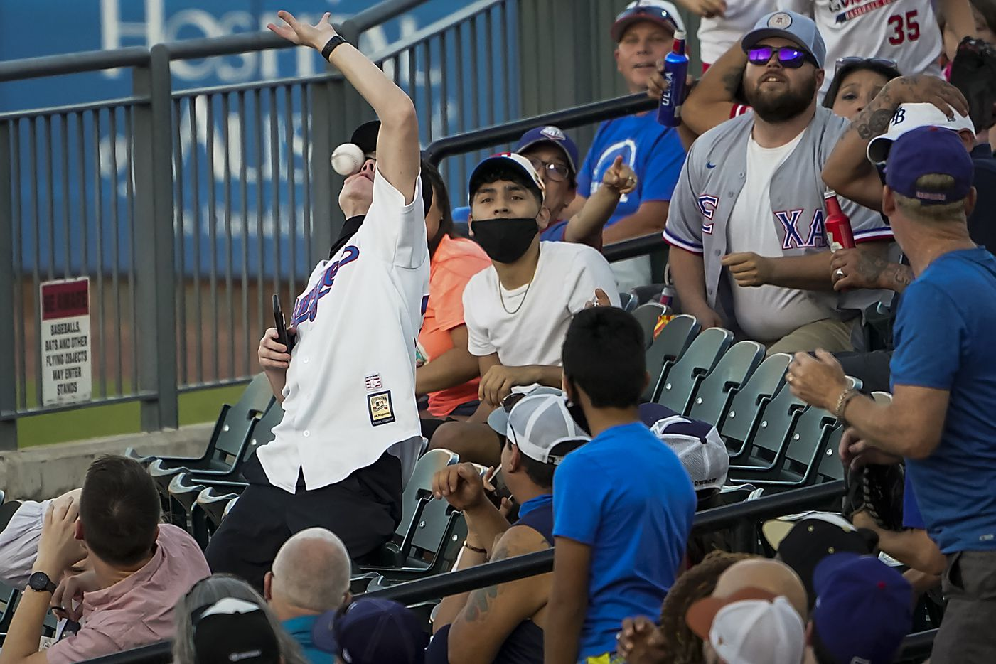 A fan is hit in the face as he tries to catch a foul ball of the bat of Round Rock Express infielder Charles Leblanc during the second inning against the Oklahoma City Dodgers at Dell Diamond on Thursday, May 6, 2021, in Round Rock, Texas. The injured fan left the stadium with medical personnel.  Leblanc later homered in the at bat.