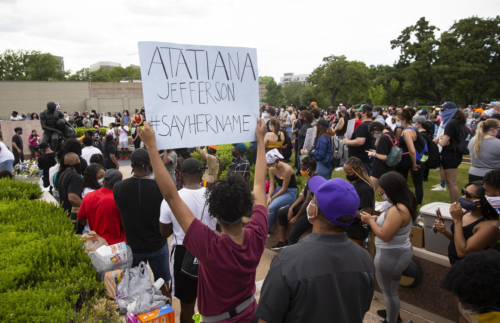 Among the signs held Sunday at the Freedman's Cemetery demonstration was one referencing Atatiana Jefferson, killed last October by a Fort Worth police officer as she and her nephew played a video game in their home.